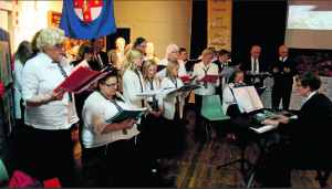 The Wollemi Voices sang stirring songs on Friday evening and received a traditional three cheers from the audience following their performance.